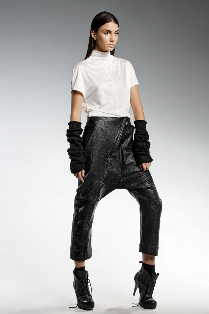 Unisex eco leather pants with front zipper detailing, two front and one back pocket.