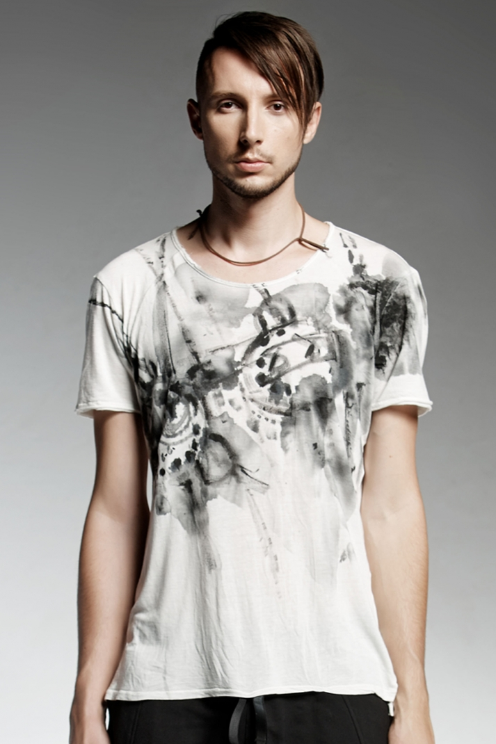 White handmade drawn man's T-shirt with a round neck line.